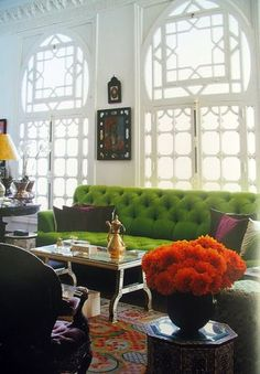 This green tufted couch is gorgeous!
