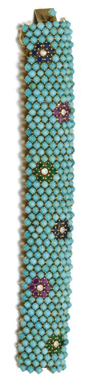 Gem set and diamond bracelet; cabochon turquoise with flower motifs set with emeralds, rubies, and sapphires, each centering on a diamond. Via Sotheby's.
