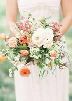 Gorgeous Bouquet Showcasing A Peach/Pink/Orange/Coral/White Color Palette: Roses, Garden Roses, Zinnias, Ranunculus, Camellias, Hellebores, Clematis, Orchids, Green Seeded Eucalyptus, Lily Grass, Green Anthurium
