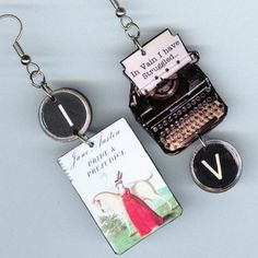 Somebody used our book jacket for earrings! AND one of our all-time favorite Mr. Darcy quotes from P&P. TOTALLY AWESOME.