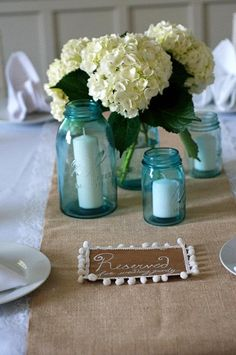 Mason jars and hydrangeas. Use candles in non floral jars