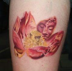 Beautiful idea, putting script and Buddha's face on the lotus petals.