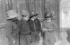 Spain - 1938. - GC - Children playing war with steel helmets - no further…