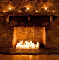 This looks like the coziest place in the world. I love the idea of putting candles inside a fireplace.