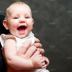 A beautiful smiling baby by Lopatin Photo on @creativemarket