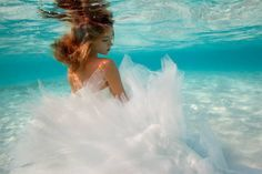 "Elena Kalis is a Bahamas-based photographer who does amazing underwater photography. This is her bridal series — a whole new and moody way to ""trash the dress."""