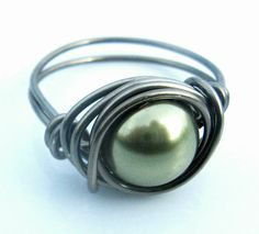 This looks like a bisque and beads ringg.