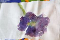 Flower pounding prints! Such a cool idea. And my boy would love to smash the crap out of a flower, too. ;)