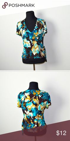 Gorgeous Blue Abstract Print Blouse In excellent condition! Very comfortable, feminine, and flattering! Buy 3 items and get 1 free plus 15% off your purchase total! Tops Blouses