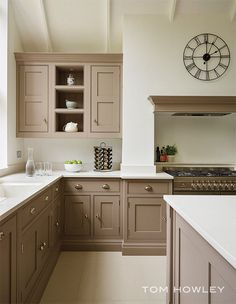 A contemporary twist on a classic shaker kitchen, including feature island, bespoke storage and built-in luxury appliances. Taupe Kitchen Cabinets, Tan Kitchen, Small Cottage Kitchen, Kitchen Cabinet Colors, Shaker Kitchen, Painting Kitchen Cabinets, Kitchen Redo, Home Decor Kitchen, Kitchen Interior