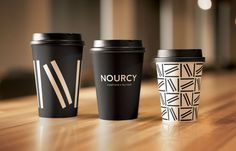 Branded coffee cups designed by for Quebec City delicatessen Nourcy Logo, logotype, print, packaging and interior designed by Canadian studio for Quebec City delicatessen Nourcy. Opinion by Richard Baird Coffee Packaging, Coffee Branding, Brand Packaging, Packaging Design, Food Packaging, Café Branding, Restaurant Branding, Branding Design, Brand Identity