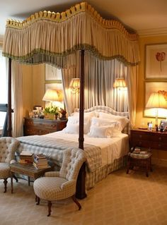 The golds & greys are a good combination of warm & cool tones. I love the wall mounted swing arm lamps, but think they're mounted too high- would be hot on your head. I'd bring the lamps over towards the bed too to provide better light & show off the art. They don't need to be centered on larger pieces like these. Very elegant room.