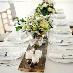 love the long table with the wooden plank in the center. So rustic yet sophisticated.