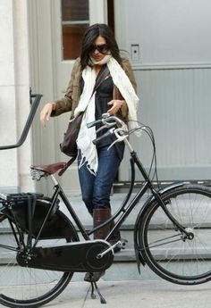 Dutch actress and 007 bond girl Famke Janssen on a Dutch bike in NYC.