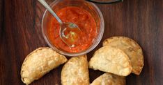 A popular snack along Senegal's coast where seafood is plentiful, these small fried hand pies are filled with a spicy herb and fish filling.