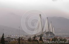 Photo about Rio Antirrion bridge, West Greece, cloudy misty background sky. Image of view, toll, bridge - 138258835 Winter Images, Rio, Greece, Bridge, Editorial, Photography, Greece Country, Photograph, Fotografie