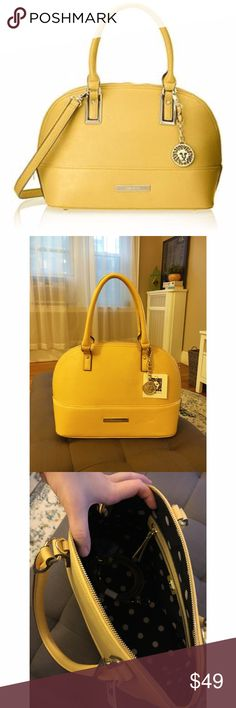 Yellow Anne Klein Handbag, Never Used Yellow handbag from Anne Klein with polka dot interior! Never used, tags still on. Comes with an extender strap to make it into a cross body bag. Lots of room inside, perfect color for autumn! Anne Klein Bags