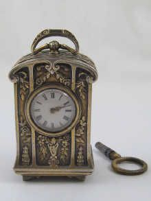 "A French hallmarked silver miniature carriage clock by Boucheron, signed ""Boucheron Paris"", the movement numbered 11367, circa 1915,"