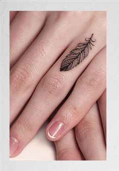 Bonus: Delicate Finger Feather - 31 of the Prettiest Mandala Tattoos on Pinterest - Photos