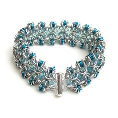 Turquoise chainmail bracelet with glass rings by TattooedAndChained, $60.00