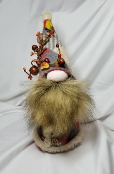 Standing 13 inches tall, this handmade Nordic gnome is sure to melt your heart. All new materials. Fleece, faux fur, polyester fiber fill and rice for weighted base. Each gnome is one of a kind, named, numbered and signed! Available in all holiday themes, occupational and traditional