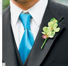 Boutonniere with green dendrobium orchids and wrapped in green bullion wire - sparkly but not too feminine