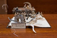 Mystery book sculptor returns -- News: The anonymous artist who caused a stir has opened a fresh chapter of filigree scissor work -- Robert Burns poem Tam O'Shanter