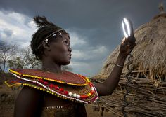 Pokot tribe girl and ringflash    By Eric Lafforgue  ::   The Pokhot live in the Baringo and Western Pokot districts of Kenya and in Uganda.