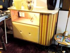 Colourful mid century dry bar.