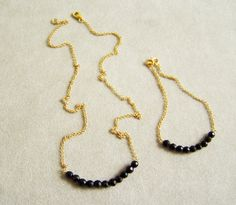 Golden chain with onyx bar thin  sterling necklace by Akatos, $33.50