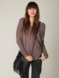 http://www.freepeople.com/whats-new/black-long-fringe-crossbody/#  also want her outfit