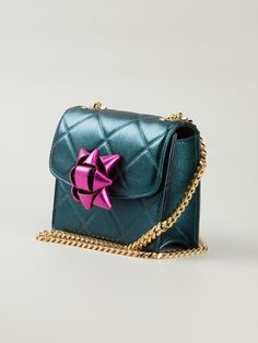 http://www.farfetch.com/shopping/women/marc-jacobs-mini-metallic-party-bow-trouble-crossbody-bag-item-10907867.aspx?storeid=9336