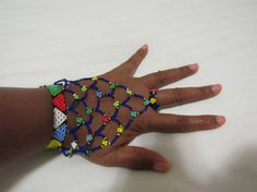 African Zulu Beaded Hand Bracelet by TheTravelSistaStore on Etsy