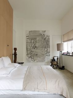 The master bedroom, with a painting by Christopher Wool.