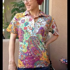 Vintage Mesh Paisley Stretch Wild Rainbow Gypsy This has shell buttons. Short sleeve. No brand label. Has that mesh nylon fabric that the brands Cosablanca and Sweet Pea use a lot. No stains, rips, snags or holes. Smoke free home. It is a button down Henley style collared shirt. Buttons are on the left side so it is a women's. Fun for a 70's party. Ask for measurements :) Vintage Tops Button Down Shirts