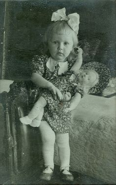 Vintage photo of ittle girl with doll, matching dresses.