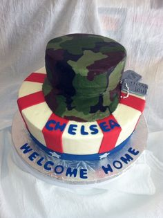 Army Life - Vanilla cake with butter cream frosting and fondant decorations.  Camo is done with various colors of butter cream.