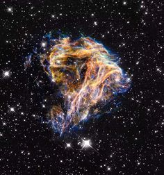 Credit: NASA and the Hubble Heritage Team (STScI/AURA) - This supernova remnant, denoted LMC N 49, within the Large Magellanic Cloud, contains delicate filaments that are actually sheets of debris from a stellar explosion.