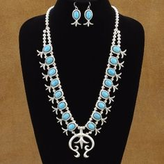 """This is just like the one on the U.S. Post Office's 2 cent stamp. This Squash Blossom Necklace is 27-1/4"""" long. The Naja is 2-1/8"""" wide and 2-1/4"""" long making this necklace hang like it's 29-1/2"""" long. The matching French hook earrings are 2"""" long. Stamped Sterling and Signed by the artist. $1650.00 #Alltribes"""