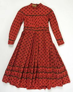 Dress Date: 1865 Culture: American Medium: wool, cotton Dimensions: [no dimensions available] Credit Line: Gift of Mrs. E. V. Anderson, 1943 Accession Number: C.I.43.126.45