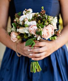 Romantic autumn bouquet of blush pink garden roses and unripe blackberries