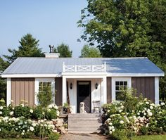 Quaint Cottage Home (House & Home) White hydrangea shrubs look stunning en masse. The homeowners transformed the original cinder-block exterior of this Caledon, Ont., home by covering it with board-and-batten siding and adding a standing-seam metal roof.