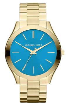 Love the blue face on this gold Michael Kors 'Slim Runway' Bracelet Watch!