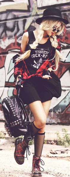 There is a lot going on here but def a feel I have gone for before. I love the edgy tank mixed with the flannel. Might not be everyone's style but the shades and hat add a stylish touch. I also love studs and that backpack is outrageous but I am into it. May solid colour shoes