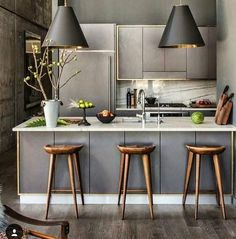 stools, grey leather panels at stool side of island