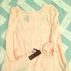 NWT pink high low shirt with gold gem studs  Brand new with tags! This pale pink high low top is super cute. It has slits on the sleeves so your arms show. It has small gold studs that are in a line design  BCX Tops Blouses