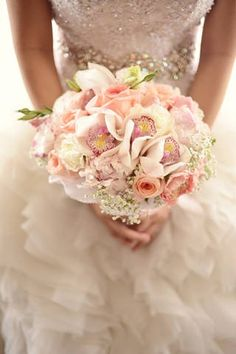 Beautiful pink and white roses, cymbidium orchids, and peonies