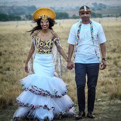 We can't get over this dress. The bodice is made out of beads. Such craftmanship😍 Designed by Zulu Traditional Attire, African Traditional Wedding Dress, Traditional Dresses Designs, Traditional Wedding Attire, African Wedding Attire, African Attire, African Weddings, African Evening Dresses, African Dress