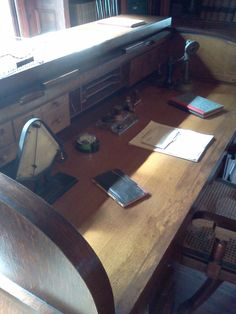 The desk of one of his staff workers in the office/library. Alva Edison, The Office, Corner Desk, Dining Table, Furniture, Home Decor, Atelier, Corner Table, Decoration Home