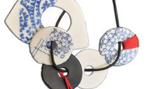 Bijoux Porcelain japanese tissue transfer jewellery.......Connie Fox: Round shapes are repeated to give unity to the piece.